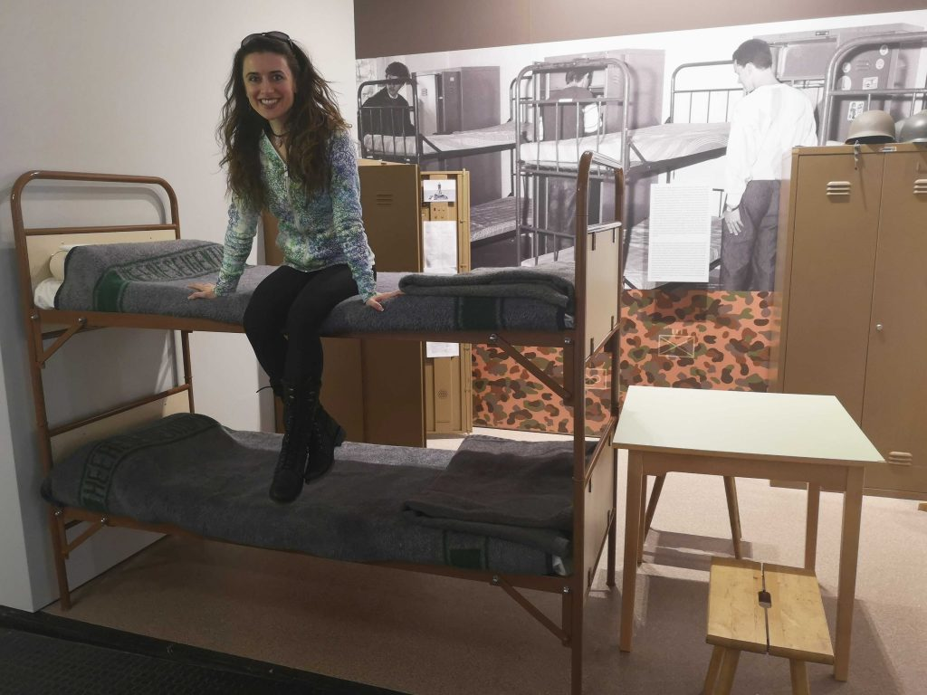 girl sitting on a military bunkbed