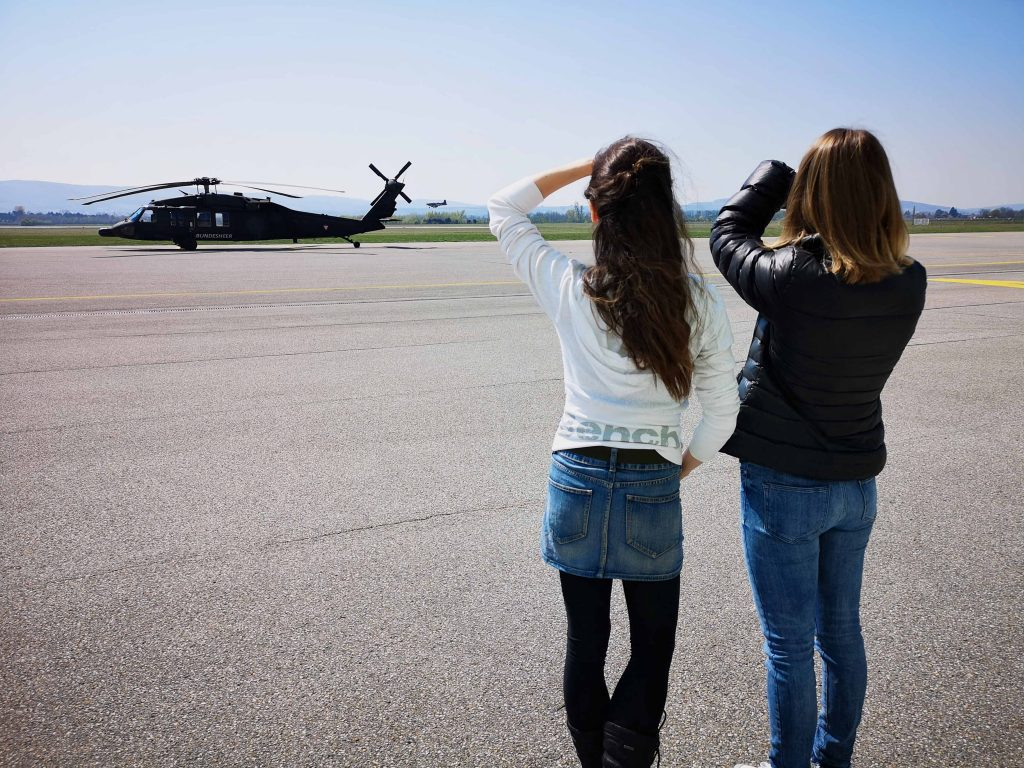 2 girls with helicopter